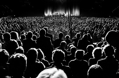 Image of an audience and stage, used in blog 7 practical ways to improve your public speaking