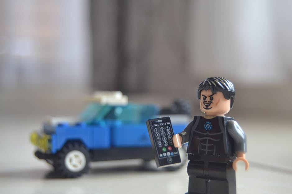 Lego man holding phone, used in blog Getting in the zone: A guide to finding flow at work