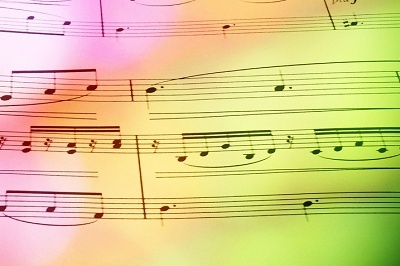 Sheet music with coloured lights, used in blog 7 practical ways to improve your public speaking