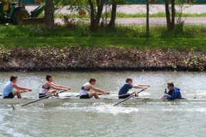 Men's rowing team practicing rowing, used in the blog 4 lessons rowing can teach us about productivity management